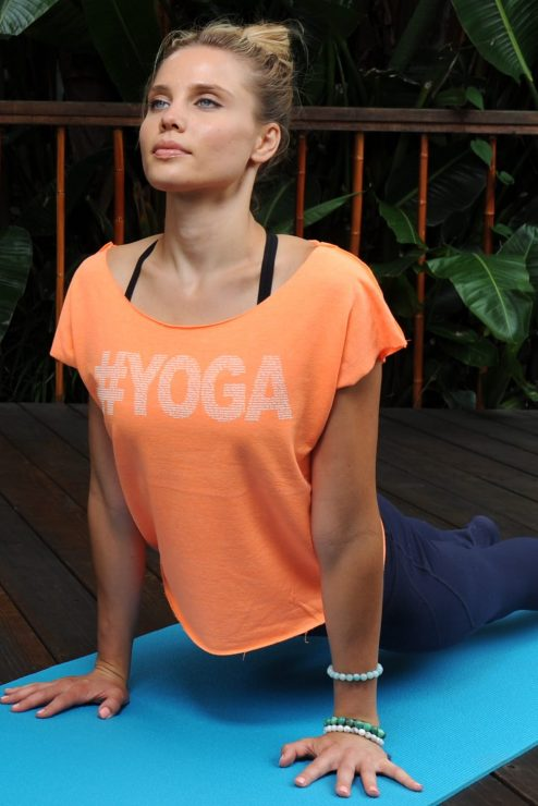 #yoga design made of positive affirmations about yoga on a cropped neon orange top