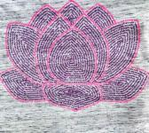 closeup image of Think Possible Apparel's lotus flower quotes design screen printed on a white marble shirt