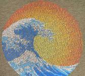 closeup image of Think Possible Apparel's great wave yin yang design screen printed on a olive shirt