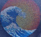 closeup image of Think Possible Apparel's great wave yin yang design screen printed on a navy shirt