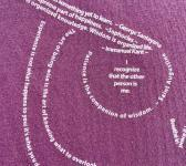 super closeup image of Think Possible Apparel's wise owl quotes design screen printed on a maroon shirt