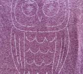 closeup image of Think Possible Apparel's wise owl quotations design screen printed on a shirt