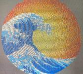 closeup image of Think Possible Apparel's great wave yin yang design screen printed on a gray shirt