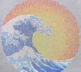 closeup image of Think Possible Apparel's great wave yin yang design screen printed on a stonewash blue shirt