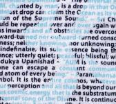super closeup image of Think Possible Apparel's om quotations design screen printed on a white shirt